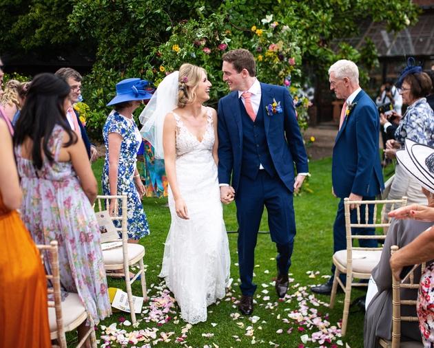 Happy couple having outdoor wedding at London wedding venue Chelsea Physic Garden
