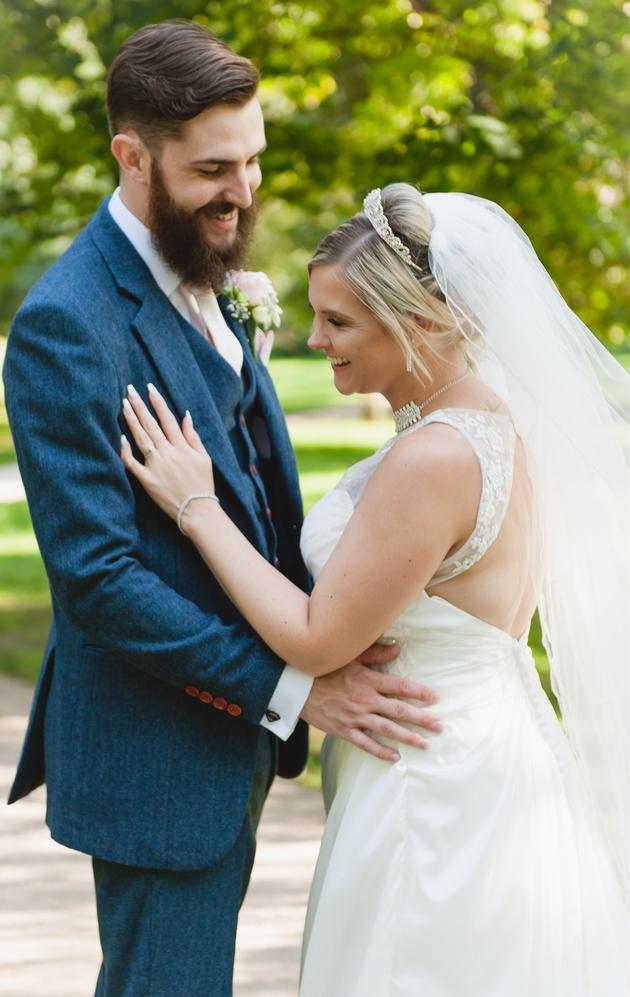 Newlyweds having photo taken on wedding day