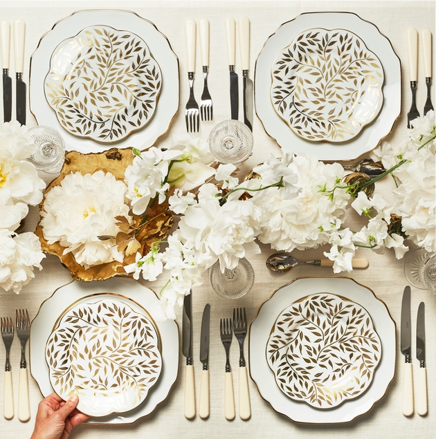 White and gold dinner set with crockery and cutlery ready for a wedding by Maison Margaux