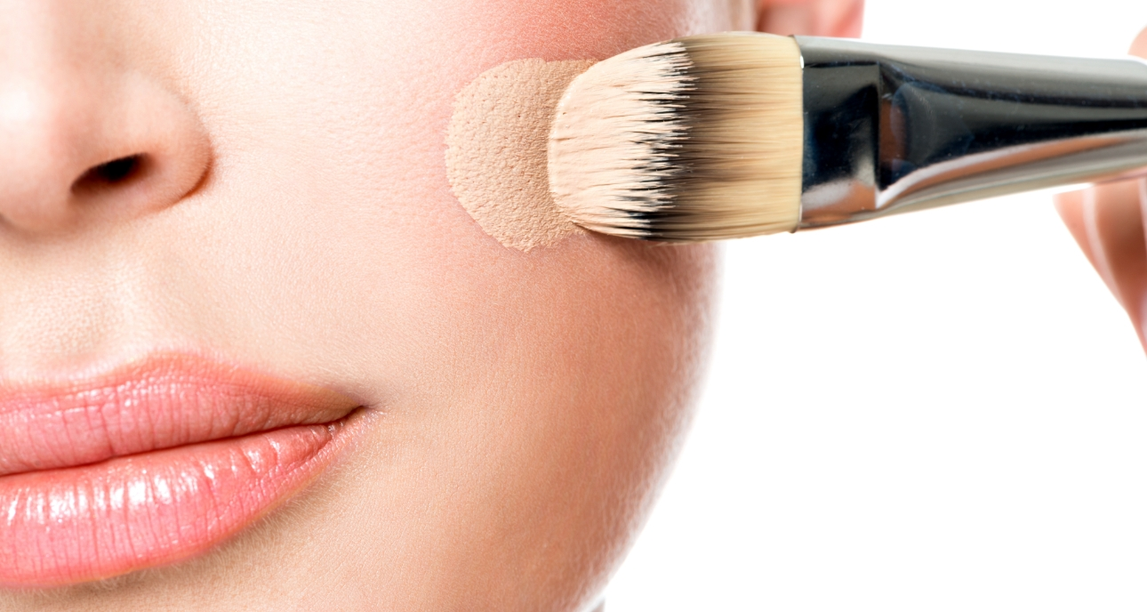 Close up of woman beginning to apply foundation