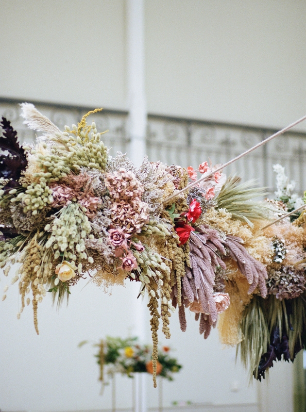 Multicoloured overhead floral installation for London wedding.