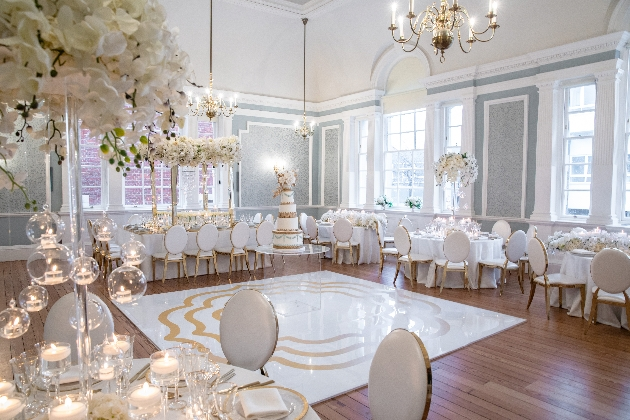 Interior of Chelsea Old Town Hall dressed in white and gold wedding decor