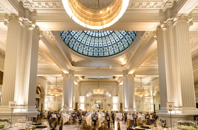 Wedding set up in ballroom of Andaz Hotel in London with columns and ivory decor