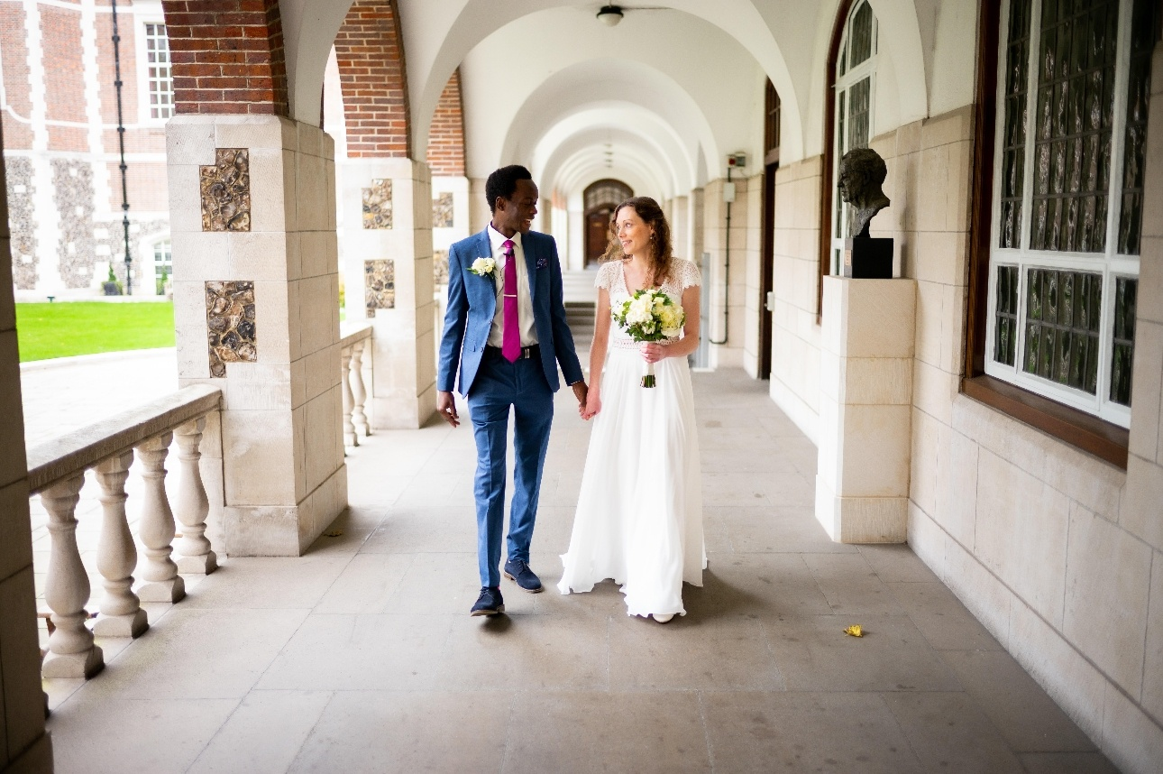 Newlywed couples walking in colonnade at Goodenough College wedding venue in Bloomsbury