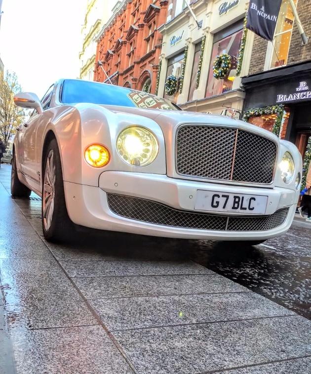 Silver Rolls Royce wedding car on London street