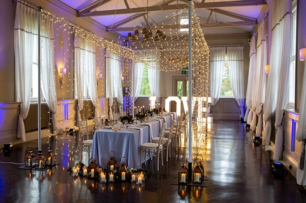 Morden Hall wedding venue set up for intimate wedding with fairy lights and love letters