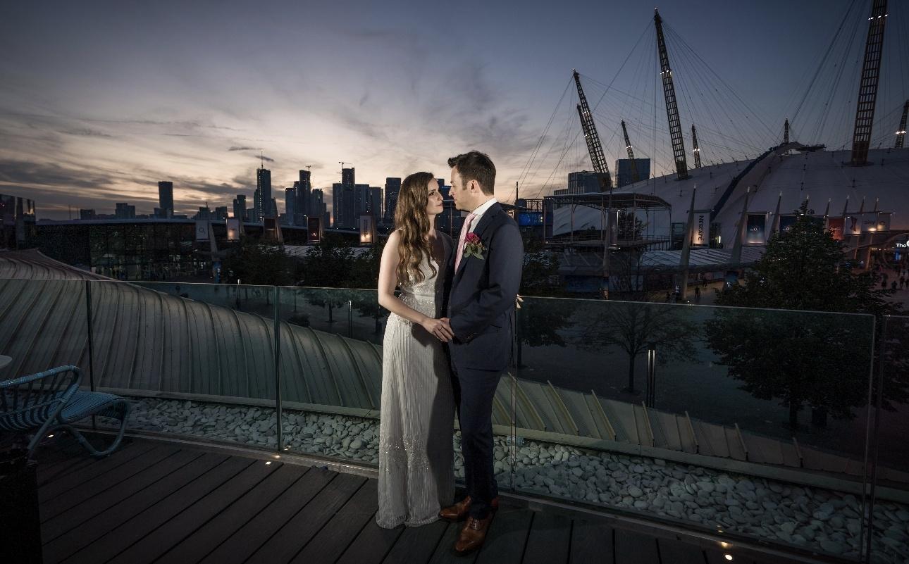 Couple on balcony overlooking the O2