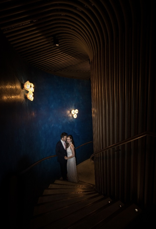 Couple pose on staircase