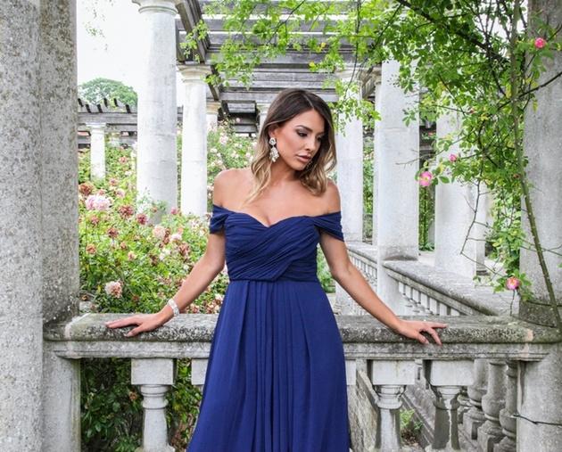 Bridesmaid wearing navy blue dress from KRISP Clothing.