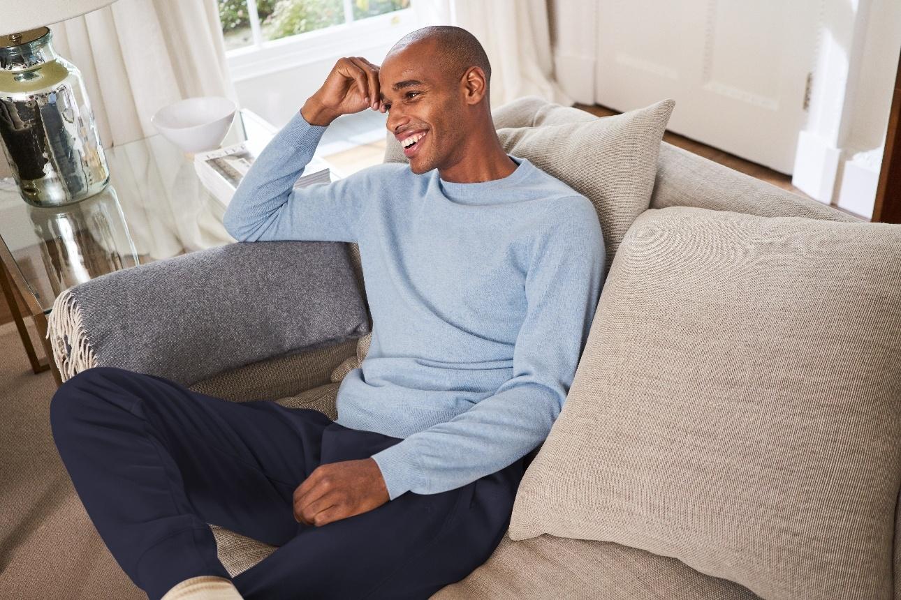 man in loungewear on sofa