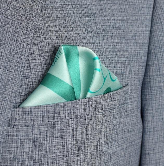 blue pocket square in grey suit jacket