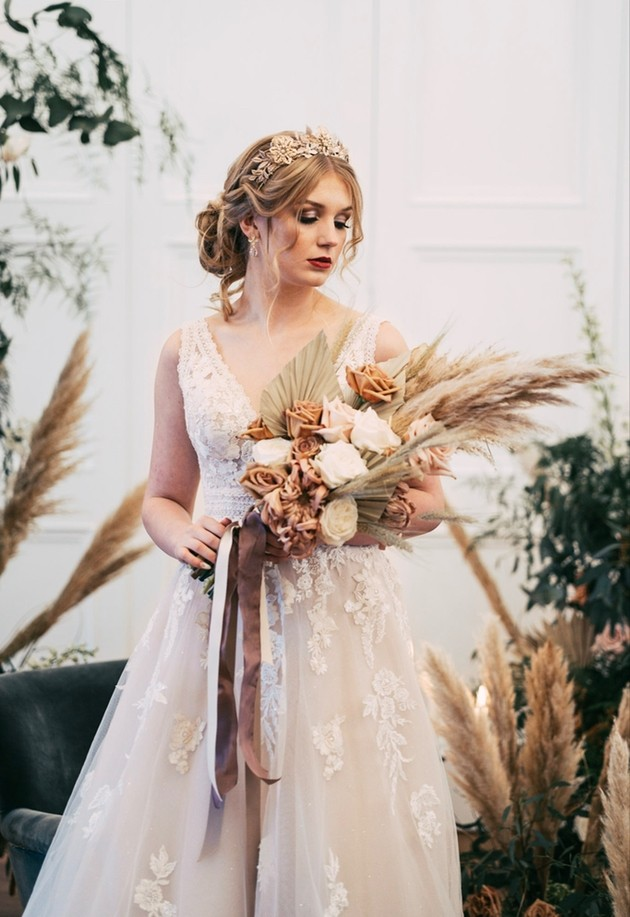 Bride holding bouquet of dried flowers and pampas grass by Harley's Flowers
