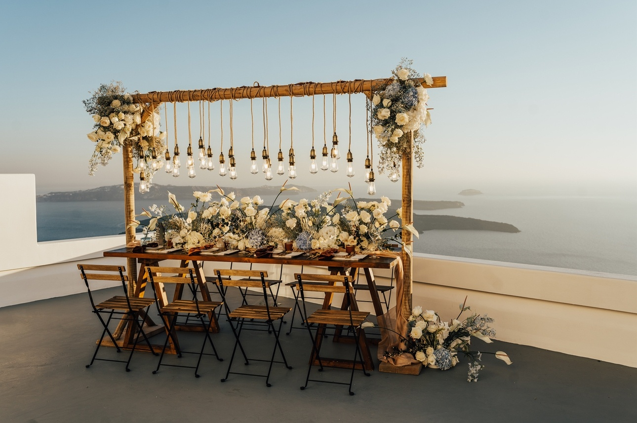 Table set up for outdoor destination wedding styled with flowers
