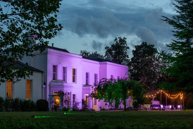 South London wedding venue Morden Hall lit up at night.