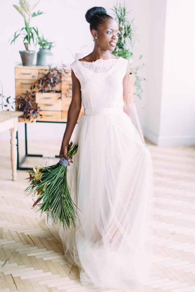 Happy bride with foliage bouquet