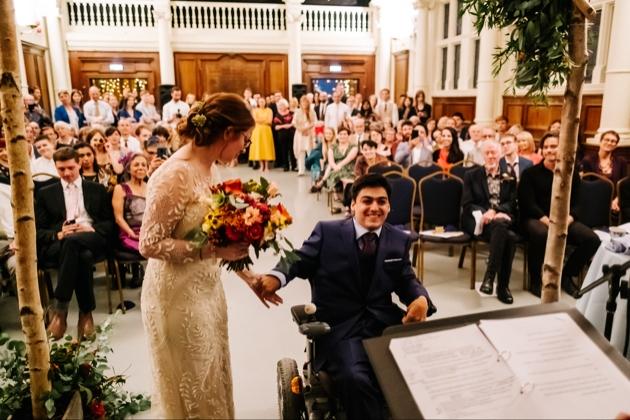 Happy couple having micro wedding.