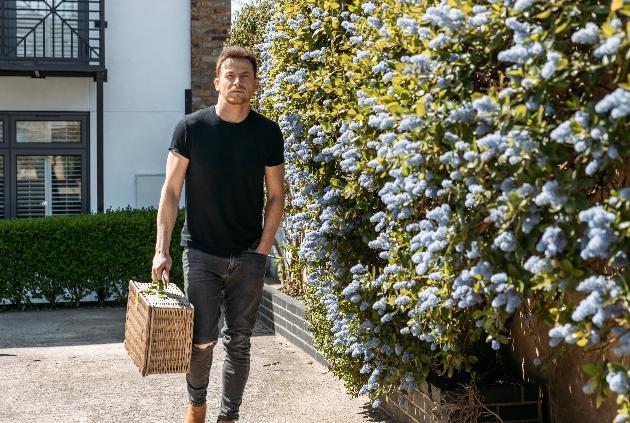 Joe walking with a hamper