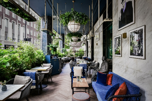 al fresco bar setting with outdoor seating and hanging plants